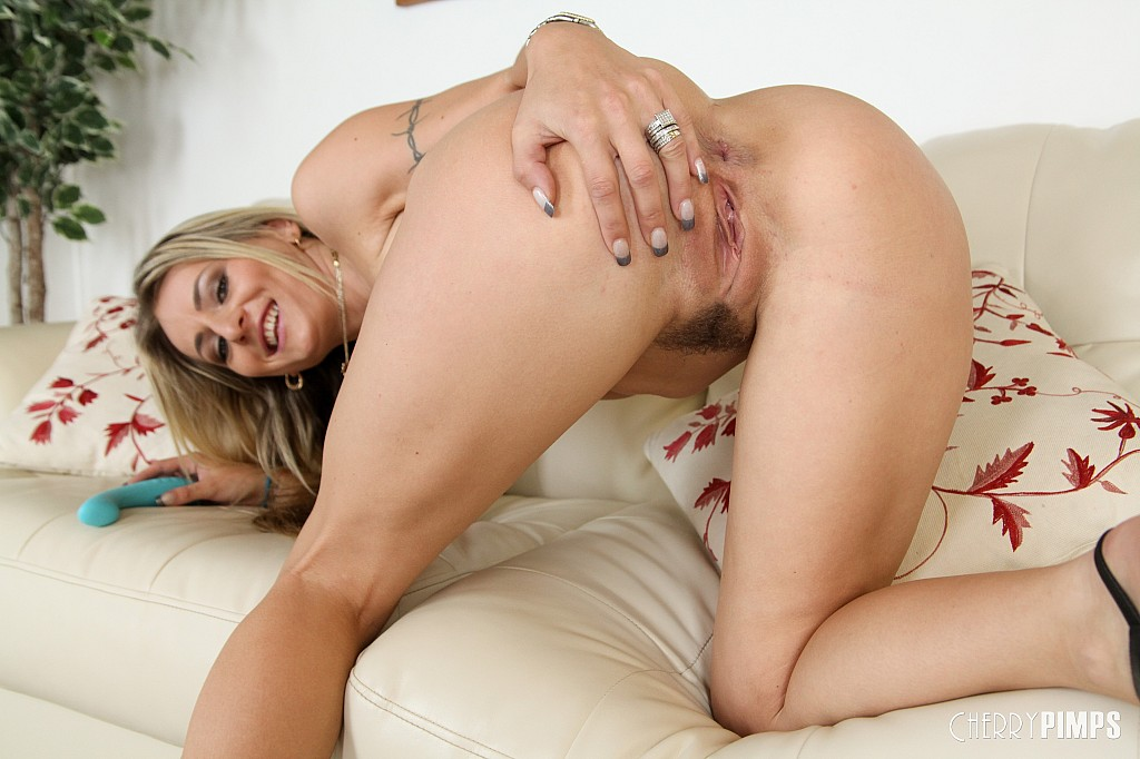 Sexy leggy Natasha Starr has nice natural tits and lovely long blonde hair.  Her blue dildo slides to her trimmed pussy. Her cherryspot gets wetter and  ...